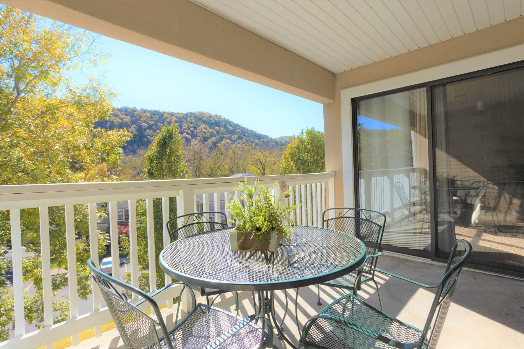 Balcony with metal patio table and chairs